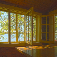 Wide open windows allow the fresh country air in.